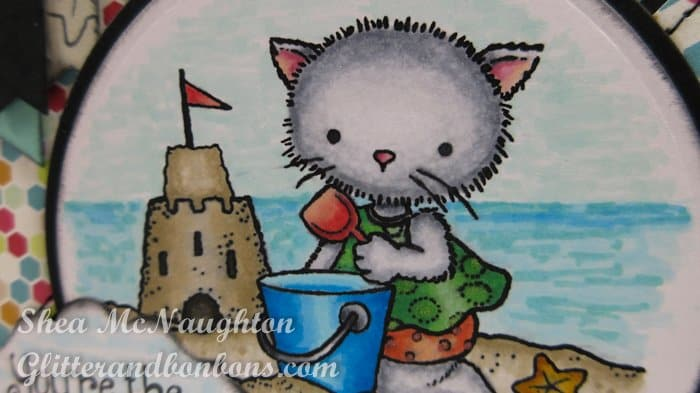 Close up of stamped and colored image of kitten on a beach