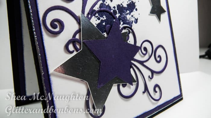 Close up image of focal point stars in purple and shiny silver cardstock