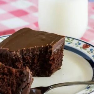 Slice of one-bowl chocolate cake with real fudge icing