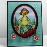 A cute birthday card featuring a baby duck image and 3-D painted flowers on embossed background. The background was embossed with another favorite paper crafting tool, the Sizzix Big Shot.