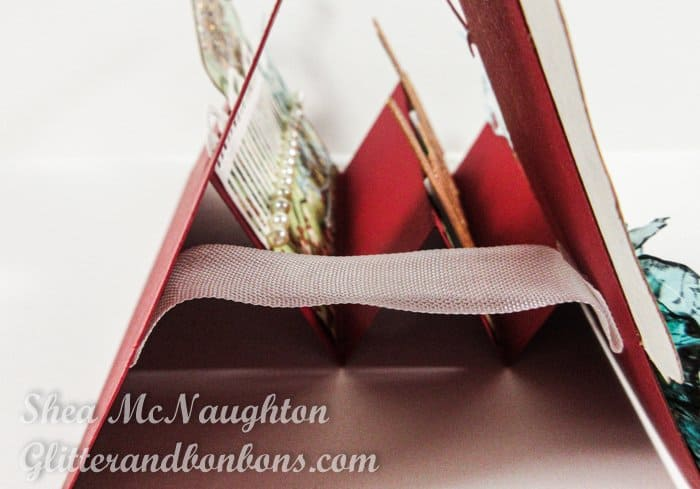A piece of ribbon acts as a stabilizer to keep the card upright