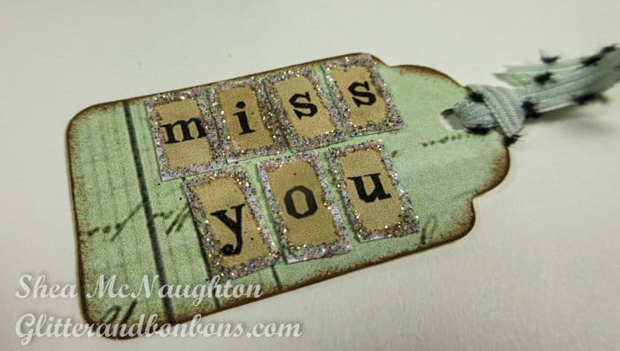 The tiny tag with a tiny message edged with glitter