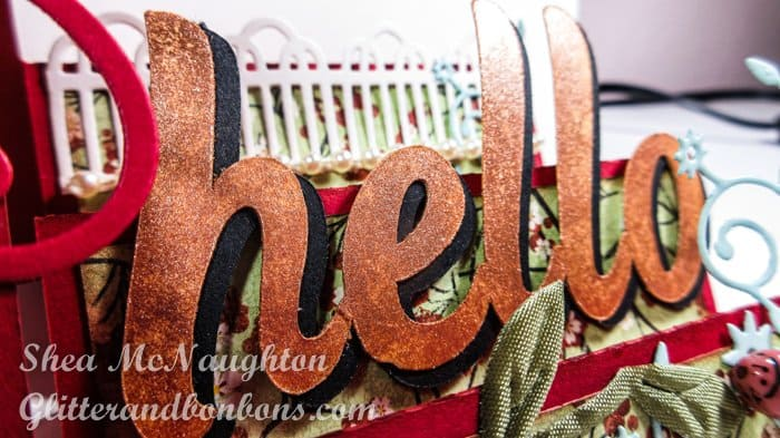 "Close up of die cut ""hello"" greeting"