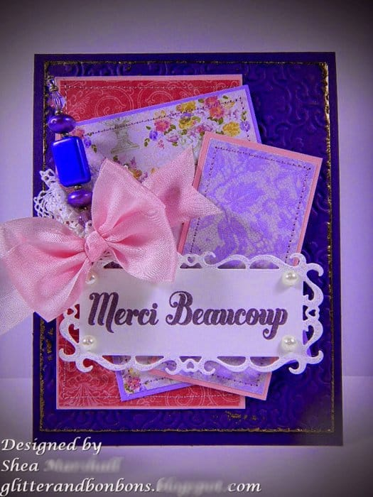 Front view of pink and purple card with French greeting