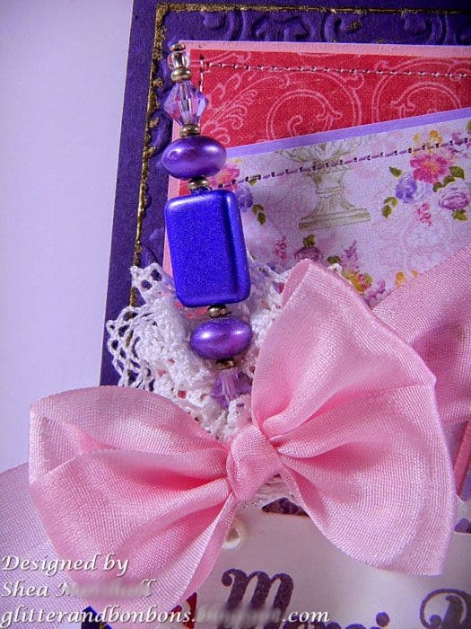 Silk bow and jeweled stick pin as embellishment