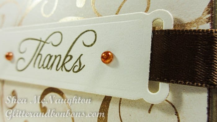 Close up of label with custom colored adhesive pearls