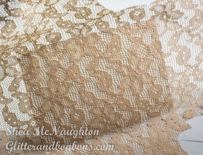 The lace is now stuck to the sticky side of the adhesive paper