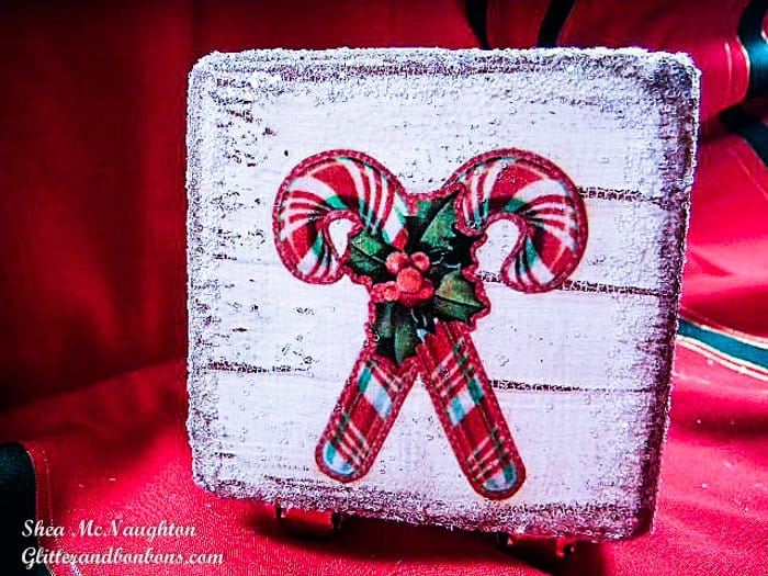 Crosssed candy canes on one side of the decoupaged wood block