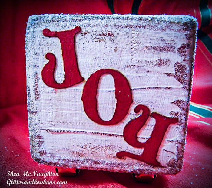 The letters J O Y cut from card stock