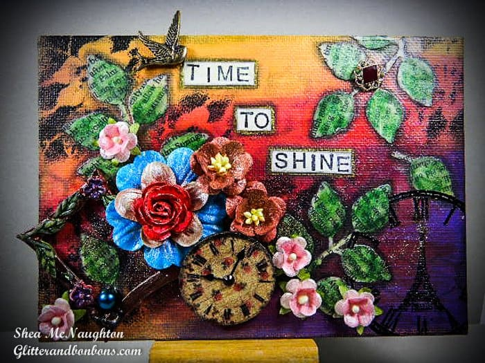 Mixed media collage using bright colors, flowers, clock references