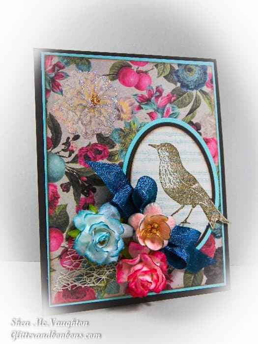 Angled vignette view of card with flowers illustrating how to color mulberry flowers