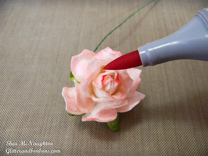 Using a contrasting marker to darken the tips of flower