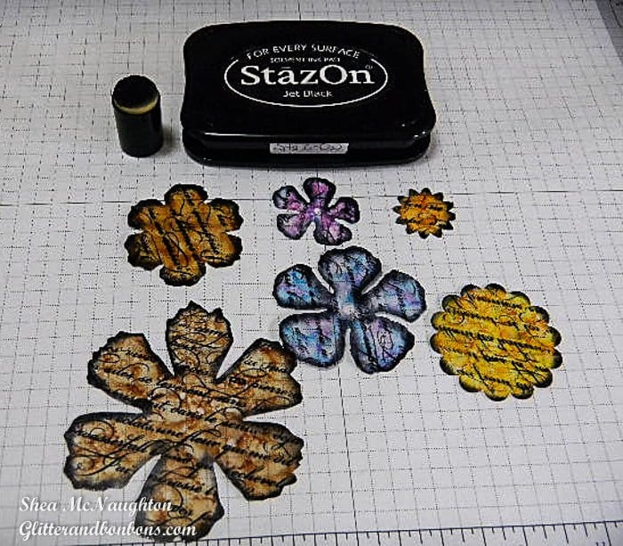 Edges of plastic flower shapes darkened with StazOn ink