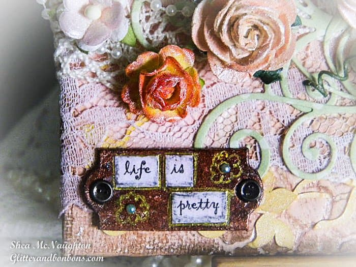 """Closeup of """"Life is Pretty"""" grungeboard tag"""
