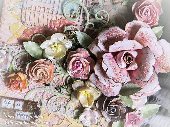 Closeup of flowers, including handmade large rose and handpainted smaller roses