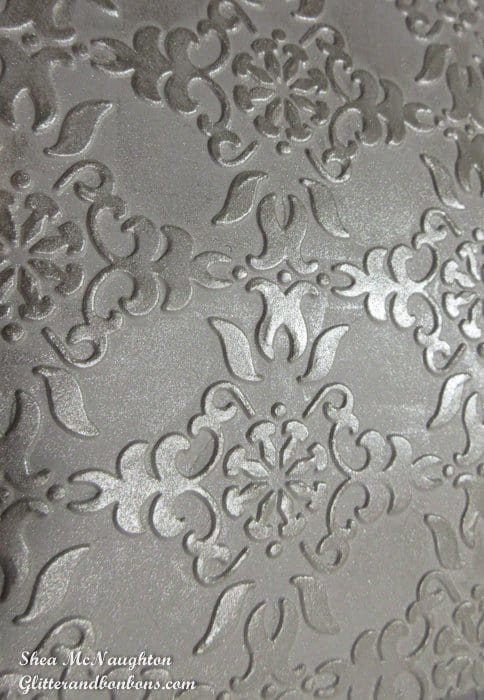 Shimmer added to embossed area brings brings out the detail