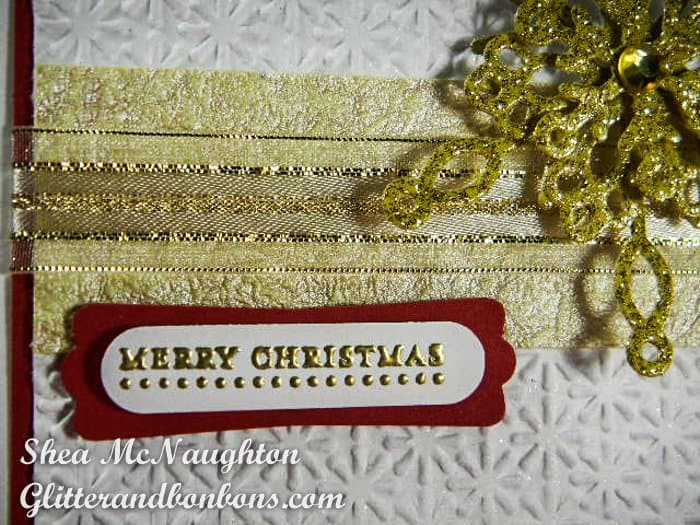 Close up of embossed greeting, layered ribbon wrap band