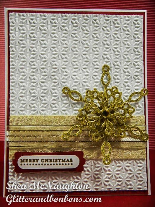 Golden snowflake card with snowflake embossed bottom layer and 2 layers of gold ribbon wrap