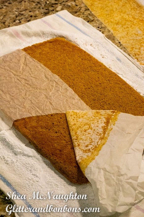 Removing the parchment from the baked cake