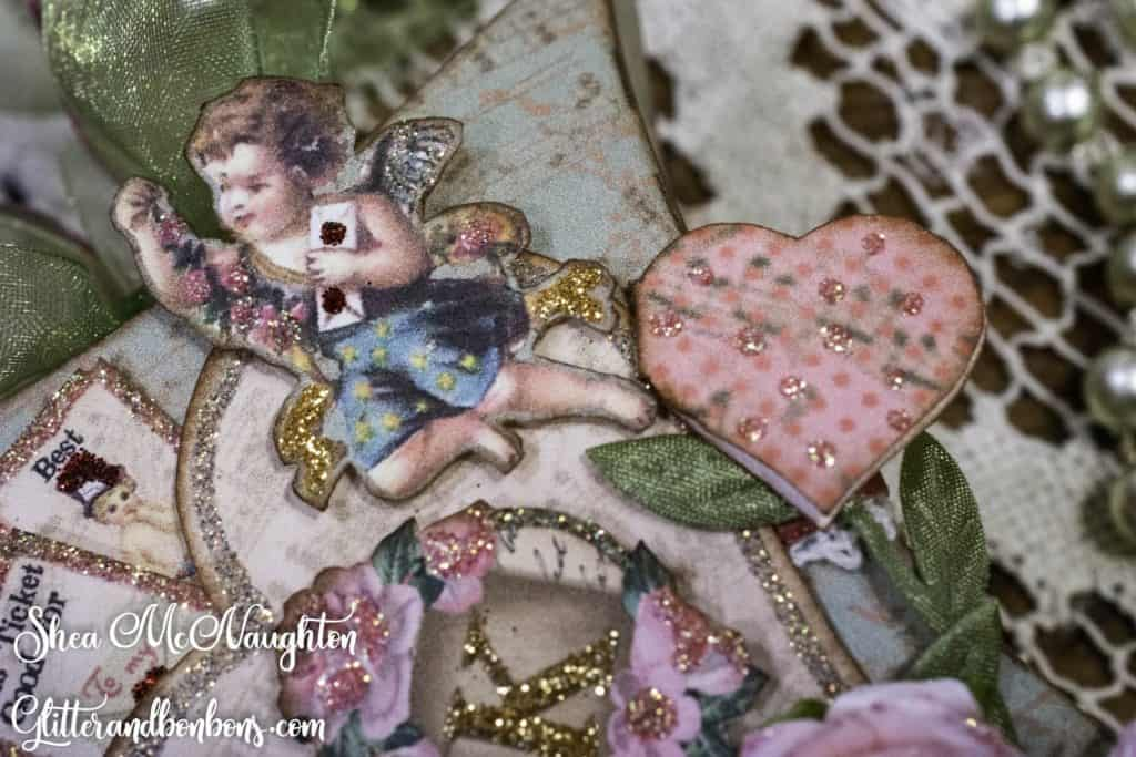 Close up of cupid image and another tiny conversation heart