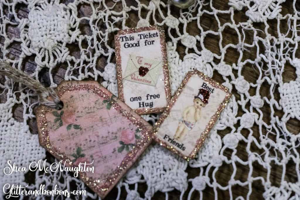 Close up of tiny tag and tiny tickets with glittered edges