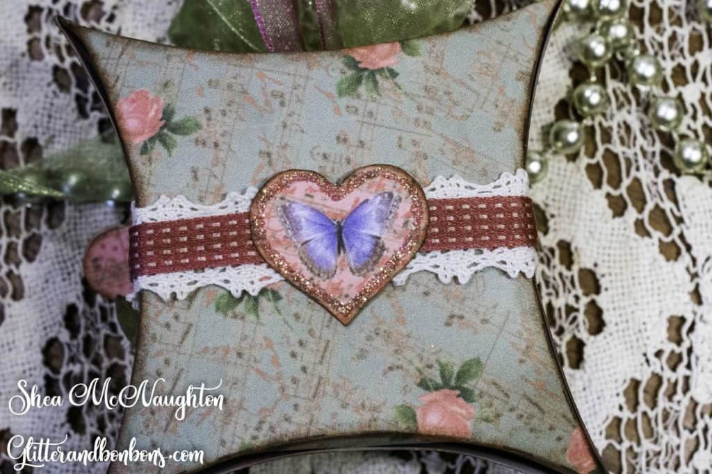 Back of the vintage pillow box with a leftover decorative element attached