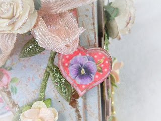 Another conversation heart close up with image of a pansy