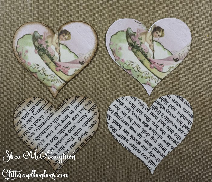 Heart shapes cut from book pages and printed card stock