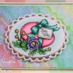Beautiful handmade Easter card featuring hand coloring and colorful designer paper
