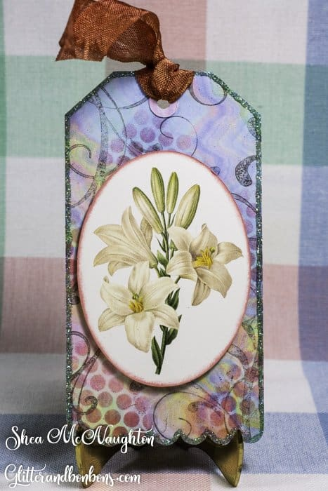 Tag art using lilies as the main image and pretty designer paper