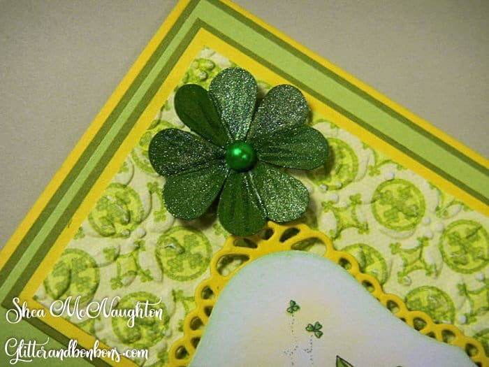 Four-leaf clover made with tiny heart punch outs, painted with shimmer paints