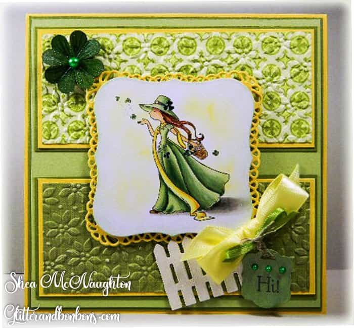 Green, yellow and white St. Patrick's Day card showing colored image of Irish girl blowing a kiss of shamrocks