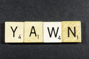 "Scrabble tiles spell out ""yawn"" for boring paper art copied from someone else"