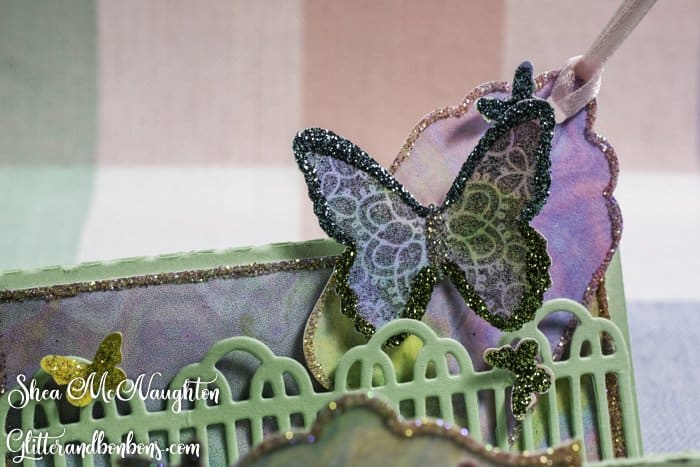 Close up of glittery large butterfly and small tag on this just because card
