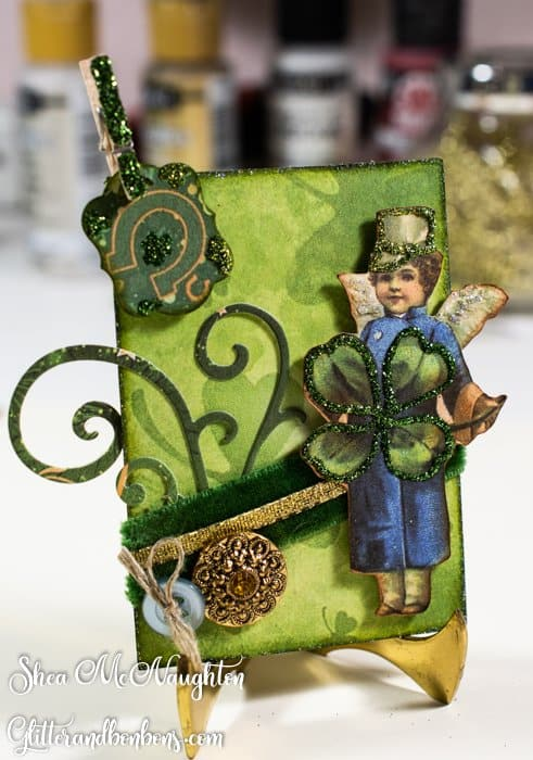 Irish lad on the second ATC with flourishes, a teensy tag, vintage buttons and vintage velvet ribbon