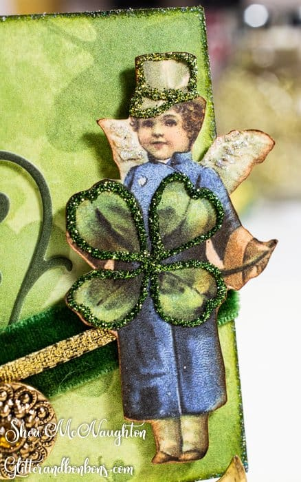 A closeup of the decked out lad with iridescent glitter on his wings