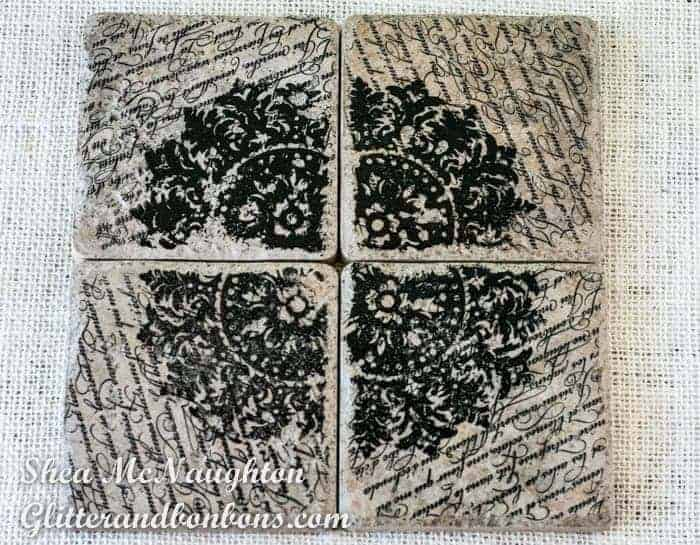 Four stamped tiles