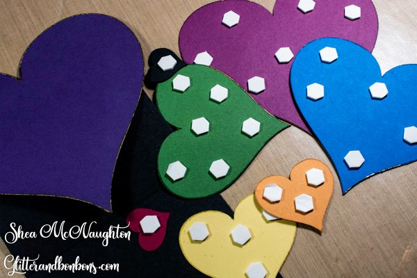 Pop dots on the backs of all the colored heart shapes