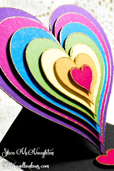 7 hearts with gold embossed edges on heart card