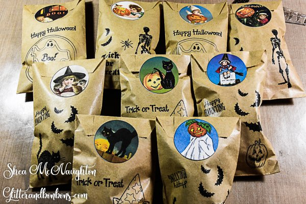 Cute stamped treat bags closed with vintage printable Halloween stickers