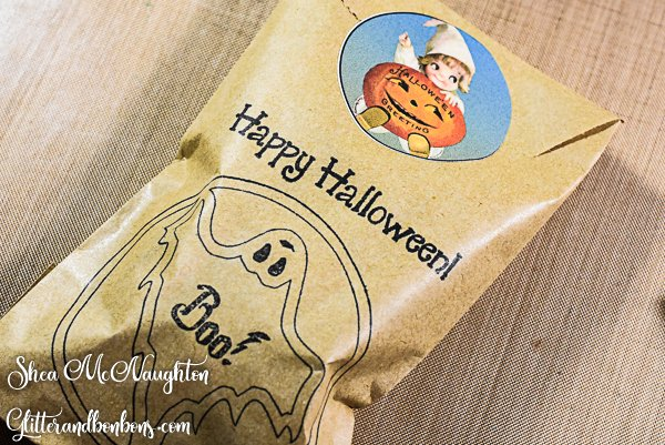 Treat bag closed with Halloween sticker showing the ghost stamp and Happy Halloween greeting
