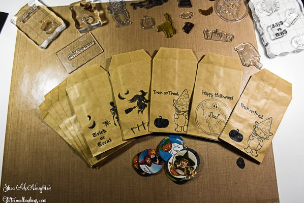 Treat bags, silicone stamps, and printable Halloween stickers ready to assemble