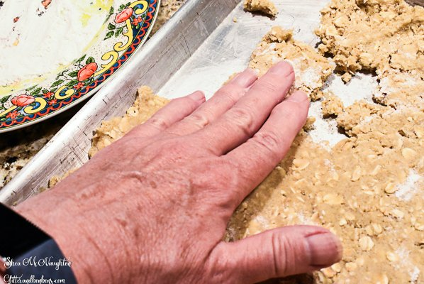 Patting the dough into the pan with my hand