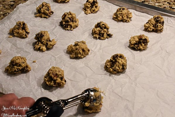 Scoops of raw oatmeal chocolate chip cookie dough using a small scoop
